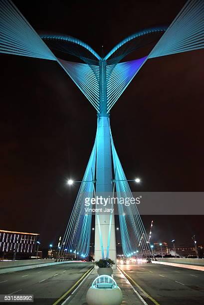 wawasan bridge by night putrajaya malaysia - futurism stock photos and pictures