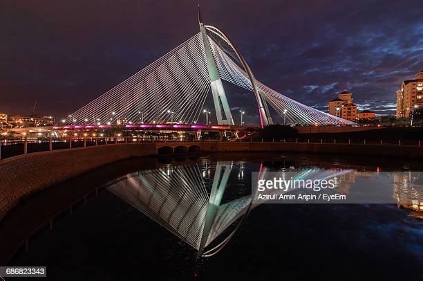 wawasan bridge putrajaya against sky at night - putrajaya stock photos and pictures