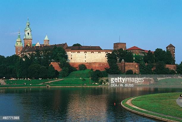 Wawel Royal Castle and the Royal Archcathedral Basilica of Saints Stanislaus and Wenceslaus on Wawel hill, with the Vistula river in the foreground,...