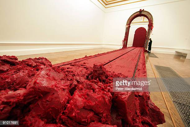 Wax deposits left by Anish Kapoor's moving train sculpture 'Svayambh' fill a gallery at The Royal Academy on September 22 2009 in London The Anish...