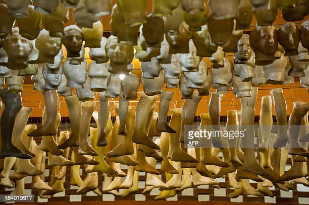Wax exvotos depicting body parts hang at an offers room at the Basilica of Aparecida in Aparecida 170 km east of Sao Paulo Brazil during the patron...