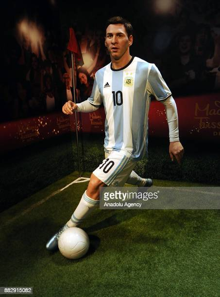A wax figure Argentine professional footballer plays Lionel Messi is seen during the press preview of the Madame Tussauds Wax Museum in New Delhi...