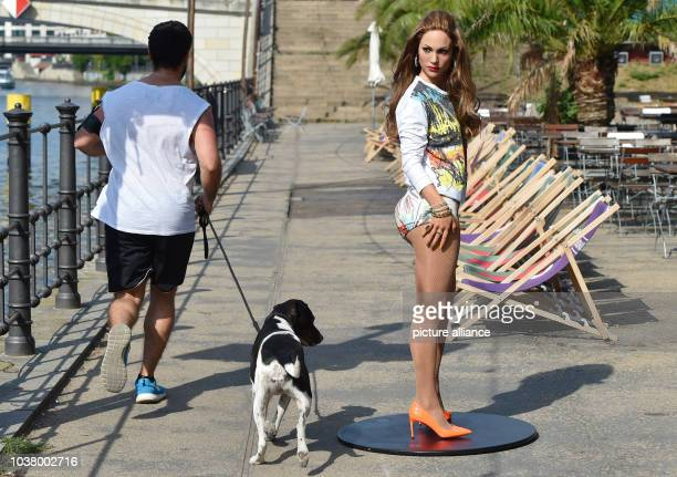 Wax figure depicting Jennifer Lopez by wax museum Madame Tussauds dressed in a new set of clothes is on display during a press event at a beach bar...