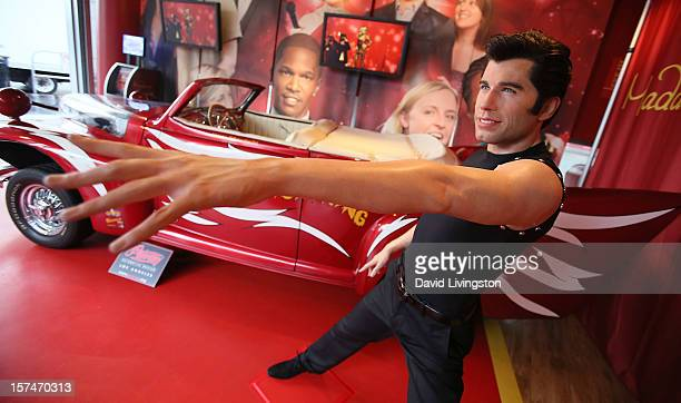 A wax figure of actor John Travolta is seen at Madame Tussauds Hollywood and the Peterson Automotive Museum unveiling of a 'Grease' themed exhibit at...