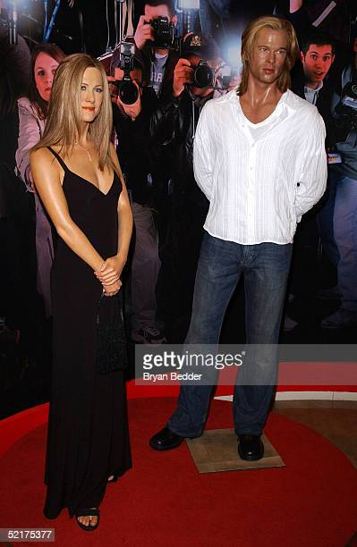 A wax figure of actress Jennifer Aniston is seen next to a wax figure of actor Brad Pitt after being unveiled at Madame Tussauds on February 10 2005...
