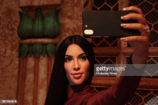 A wax figure of American reality television actress businesswoman and model Kim Kardashian displayed at Madame Tussauds Wax Museum at Connaught Place...