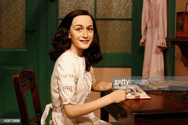 A wax figure of Anne Frank and their hideout reconstruction is unveiled at Madame Tussauds on March 9 2012 in Berlin Germany
