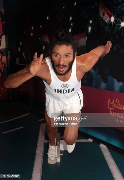 A wax figure of former Indian track and field sprinter Milkha Singh displayed at Madame Tussauds Wax Museum at Connaught Place on October 24 2017 in...