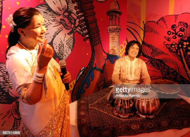 A wax figure of Indian Singer Asha Bhosle and Zakir Hussain Indian tabla player are seen during the press preview of the Madame Tussauds Wax Museum...