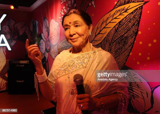 A wax figure of Indian Singer Asha Bhosle is seen during the press preview of the Madame Tussauds Wax Museum in New Delhi India on November 30 2017...