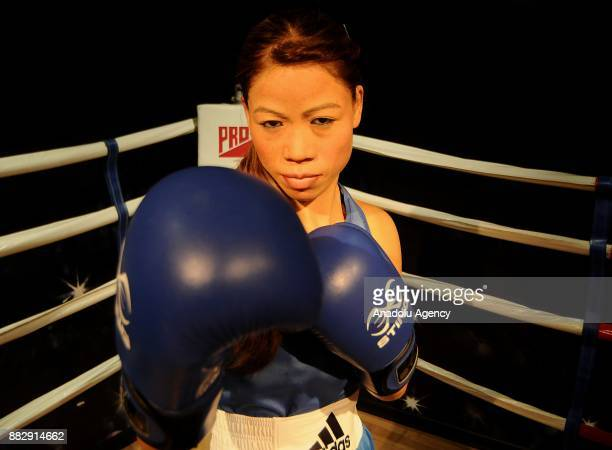 A wax figure of Indian Women's Boxing Mary Kom is seen during the press preview of the Madame Tussauds Wax Museum in New Delhi India on November 30...