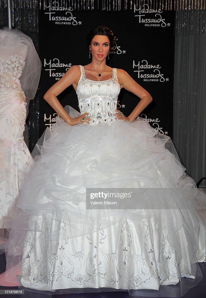 Kim kardashian wax figure unveiled in wedding dress at madame a wax figure of kim kardashian in a wedding dress is unveiled at madame tussauds hollywood junglespirit Images