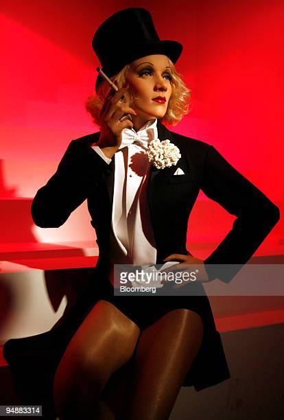 A wax figure of Marlene Dietrich German actress stands on display at Madame Tussauds prior to the exhibition's public opening in Berlin Germany on...