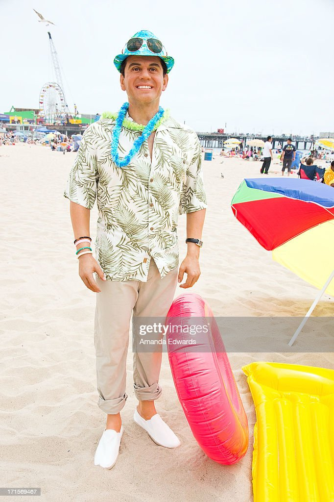 A wax figure of outgoing Los Angeles Mayor Antonio Villaraigosa enjoys 'A Day At The Beach' compliments of Madame Tussauds Hollywood at Santa Monica Pier on June 26, 2013 in Santa Monica, California.