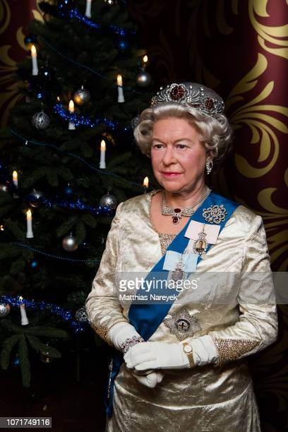 A wax figure of Queen Elizabeth II is seen during the presentation of livefigures of Meghan Duchess of Sussex and Prince Harry Duke of Sussex at...