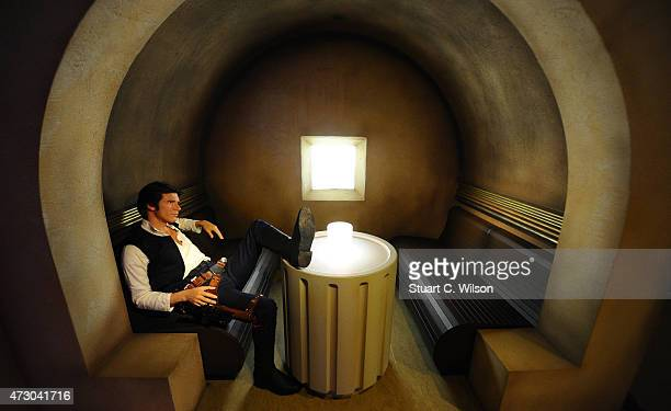 A wax figure of Star Wars character Han Solo on display at 'Star Wars At Madame Tussauds' on May 12 2015 in London England