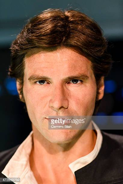 A wax figure of the actor Harrison Ford as the Star Wars character Han Solo is displayed on the occasion of Madame Tussauds Berlin Presents New Star...