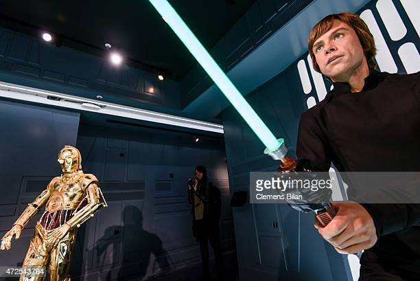 Wax figure of the actor Mark Hamill as the Star Wars character Luke Skywalker and the Star Wars robot character C-3PO are displayed on the occasion...