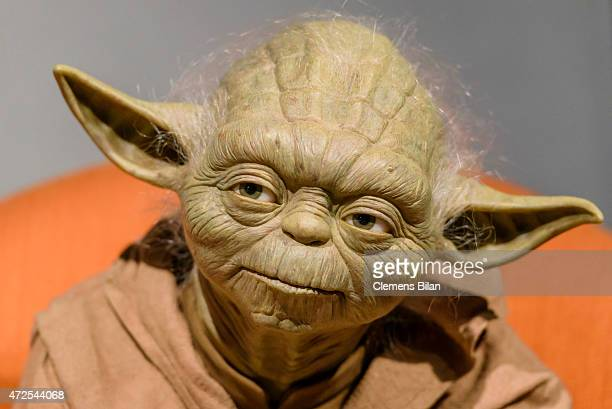 A wax figure of the Star Wars character Yoda is displayed on the occasion of Madame Tussauds Berlin Presents New Star Wars Wax Figures at Madame...