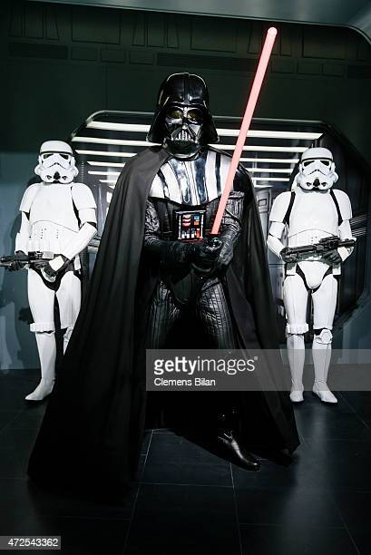 A wax figure of the Star Wars characters Darth Vader and two Stormtroopers are displayed on the occasion of Madame Tussauds Berlin Presents New Star...