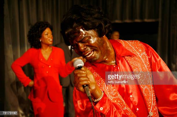 Wax figure Oprah Winfrey and James Brown stand at the Madame Tussauds Black History Month Exhibit on February 1 2007 in New York City