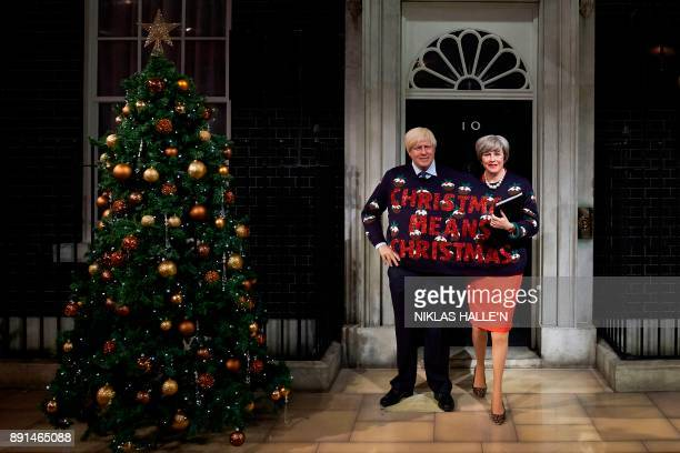 TOPSHOT Wax figures depicting Britain's Foreign Secretary Boris Johnson and Britain's Prime Minister Theresa May wearing a Christmas jumper bearing...