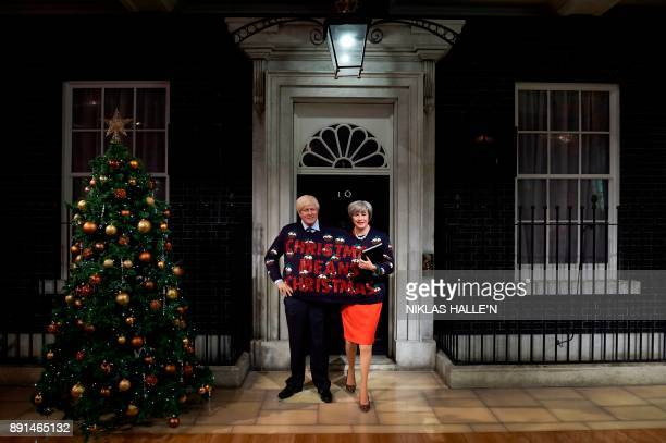 Wax figures depicting Britain's Foreign Secretary Boris Johnson and Britain's Prime Minister Theresa May wearing a Christmas jumper bearing the...