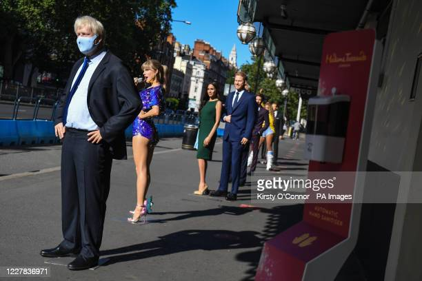 Wax figures including Prime Minister Boris Johnson US President Donald Trump and the Duke and Duchess of Sussex in the entrance line at Madame...