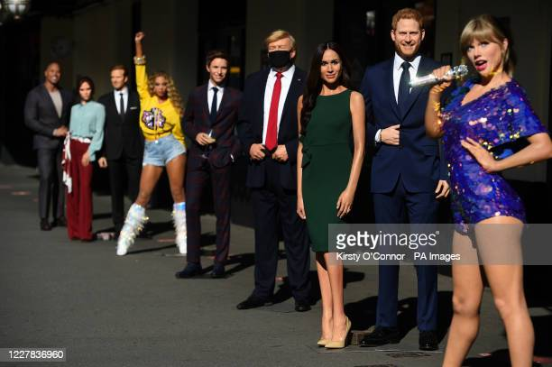 Wax figures including Taylor Swift the Duke and Duchess of Sussex US President Donald Trump and Eddie Redmayne in the entrance line at Madame...
