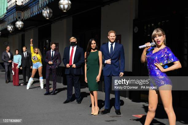 Wax figures including US President Donald Trump Taylor Swift and the Duke and Duchess of Sussex in the entrance line at Madame Tussaud's in London as...