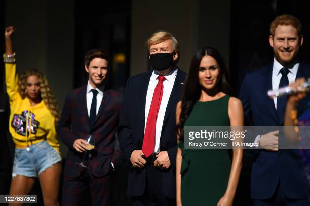 Wax figures including US President Donald Trump the Duke and Duchess of Sussex and Eddie Reymayne in the entrance line at Madame Tussaud's in London...