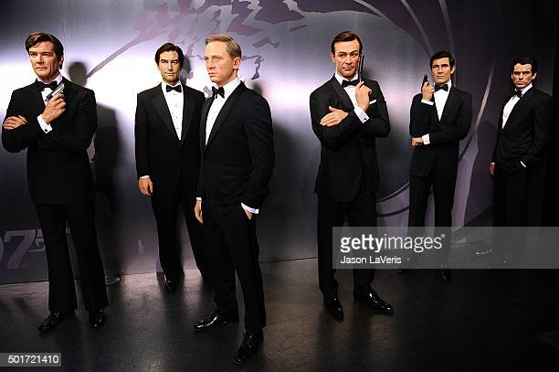 Wax figures of actors Sean Connery Pierce Brosnan Daniel Craig Roger Moore George Lazenby and Timothy Dalton as the character James Bond are...