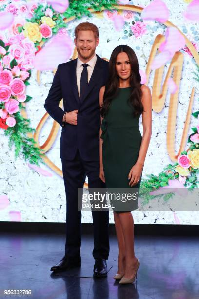 Wax figures of Britain's Prince Harry and his US fiancee Meghan Markle are pictured during a photocall at Madame Tussauds in central London on May 9...
