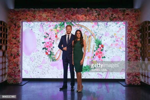 TOPSHOT Wax figures of Britain's Prince Harry and his US fiancee Meghan Markle are pictured during a photocall at Madame Tussauds in central London...