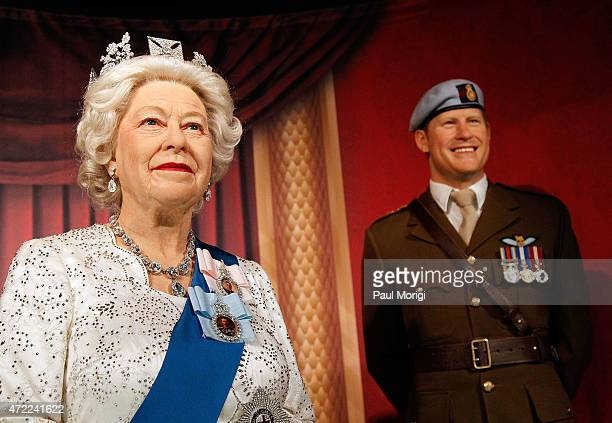 Wax figures of British Royal Family members Queen Elizabeth II and Prince Harry are unveiled at Madame Tussauds on May 5 2015 in Washington DC