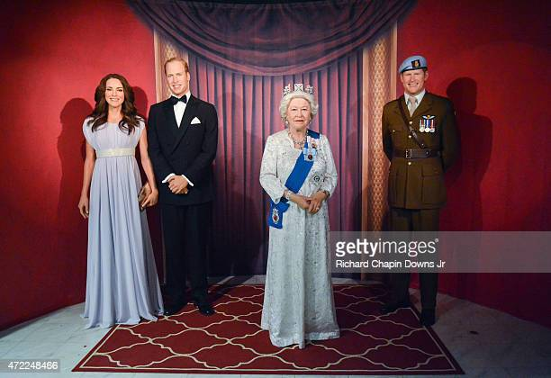 Wax figures of Catherine Duchess of Cambridge Prince William Duke of Cambridge Queen Elizabeth II and Prince Harry are unveiled as The British Royal...