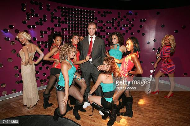 Wax figures of Christina Aguilera Justin Timberlake and Jessica Simpson are displayed with dancers during the opening of Club MTNY featuring Justin...