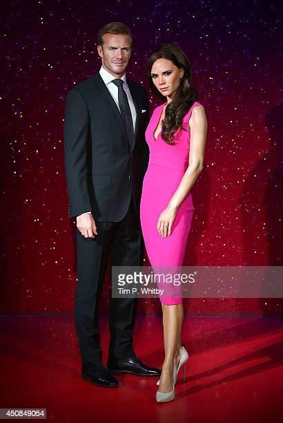 Wax figures of David Beckham and Victoria Beckham are unveiled at Madame Tussauds on June 19 2014 in London England