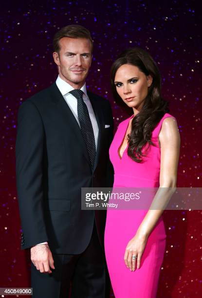 Wax figures of David Beckham and Victoria Beckham are unveiled at Madame Tussauds on June 19, 2014 in London, England.