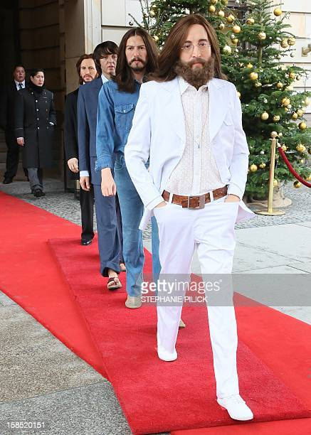 Wax figures of John Lennon George Harrison Paul McCartney and Ringo Starr as the 'Abbey Road' Beatles stand at the entrance to the Adlon hotel in...