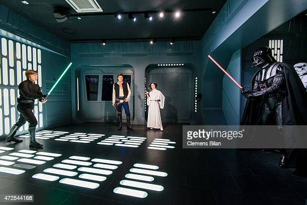 Wax figures of Mark Hamill as the Star Wars character Luke Skywalker, Harrison Ford as the Star Wars character Han Solo, Carrie Fisher as the Star...