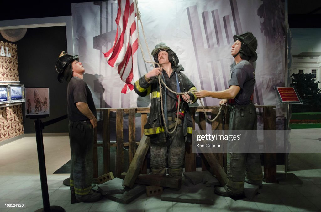 Wax figures of New York City firefighters raising the flag at ground zero are displayed during the Madame Tussauds 'HOPE: Humanity And Heroism' 9/11 Wax Exhibition at Madame Tussauds on May 10, 2013 in Washington, DC.