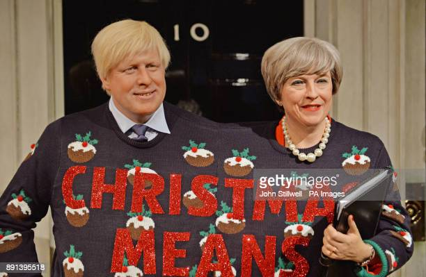 Wax figures of Prime Minister Theresa May and Foreign Secretary Boris Johnson wearing a festive jumper in support of Save the Children's Christmas...