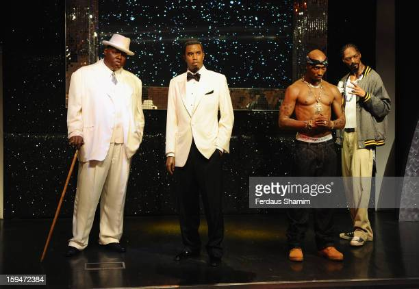 Wax figures of rap stars Biggie Smalls P Diddy Tupac Shakur and Snoop Dogg are exhibited for the first time together in London at Madame Tussauds on...