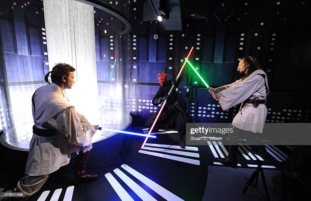 Wax figures of Star Wars characters Ben Kenobi, Darth Maul and Qui Gon Yin on display at 'Star Wars At Madame Tussauds' on May 12, 2015 in London, England.