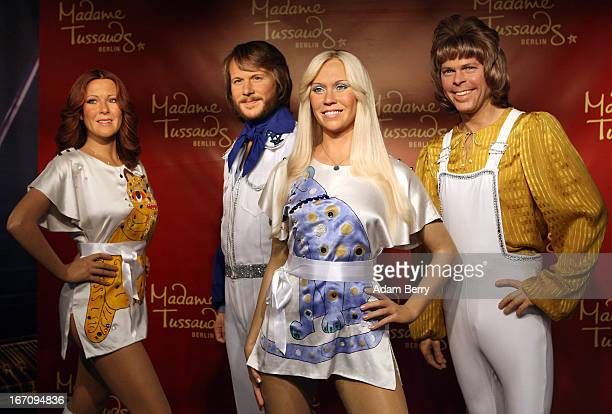 Wax figures of the members of the Swedish pop group ABBA AnniFrid Lyngstad Benny Andersson Agnetha Faltskog and Bjoern Ulvaeus wearing copies of the...