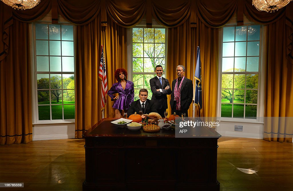 Wax figures of US musician Rihanna (L), actors George Clooney (2nd L) and Morgan Freeman (R) join US President Barack Obama (2nd R) in a recreation of the Oval Office for Thanksgiving at Madame Tussauds in London on November 21, 2012.