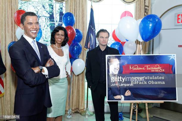 Wax figures of US President Barack Obama First Lady Michelle Obama and Leonardo DiCaprio are displayed as Madame Tussauds New York celebrates...