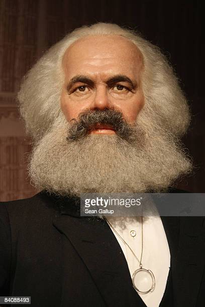 A wax firgure of 19thcentury political theorist Karl Marx stands on display at Madame Tussauds on December 19 2008 in Berlin Germany Karl Marx...