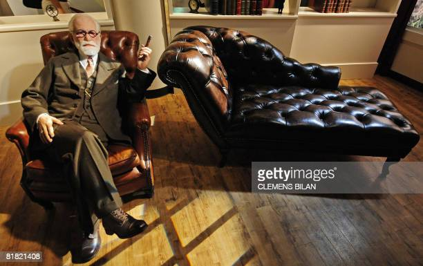 A wax likeness of Austrian founder of the psychoanalysis Sigmund Freud sits in Berlin's Madame Tussaud's wax museum during a press preview of the...